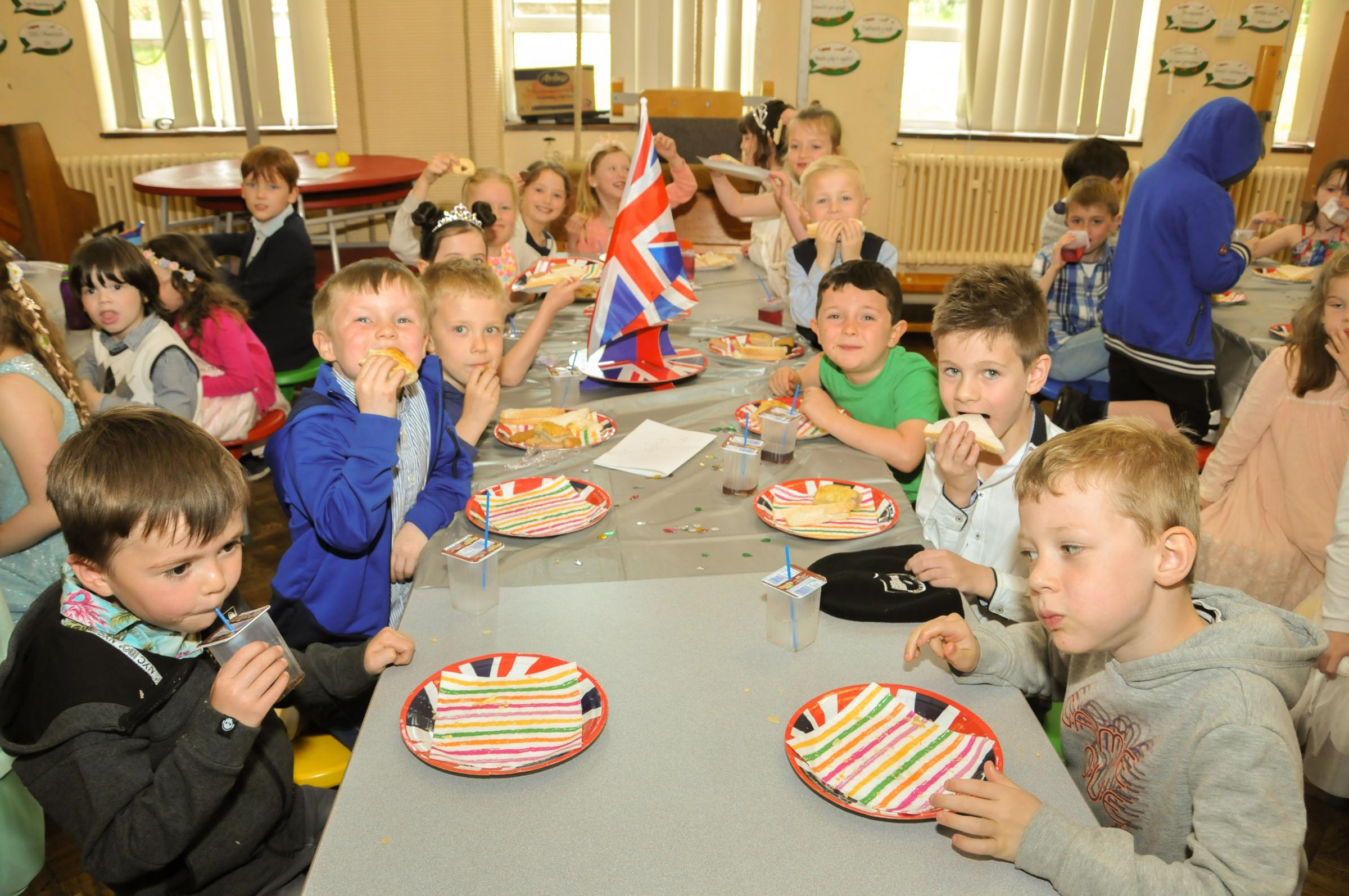Rhoseesmor, Royal Wedding Street Party at Ysgol Rhos Helyg.  Picture year one pupils having fun eating sandwiches, jelly and cake...SW17518C.