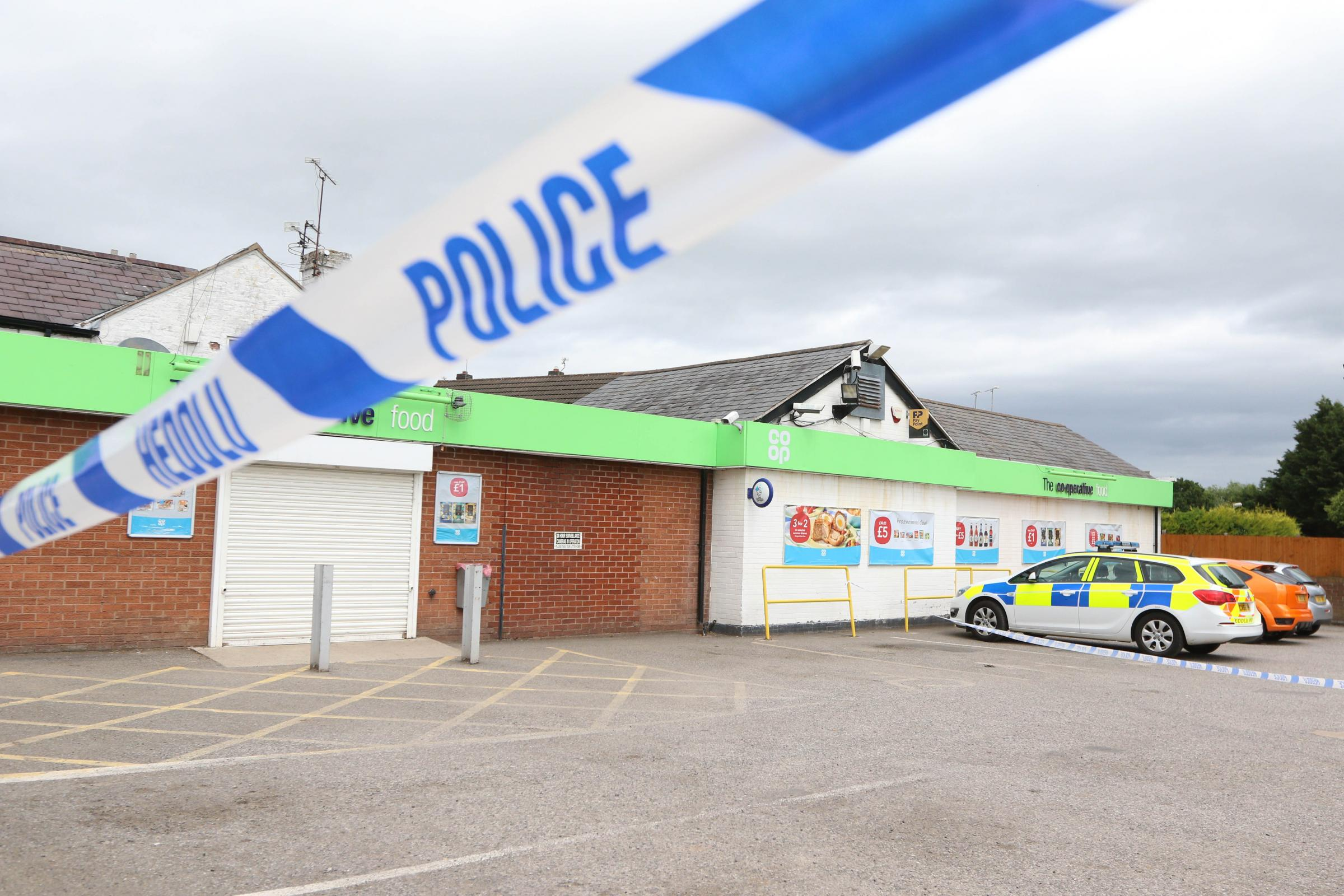 Police at the Co-op at Cross Lanes, Wrexham on Monday morning
