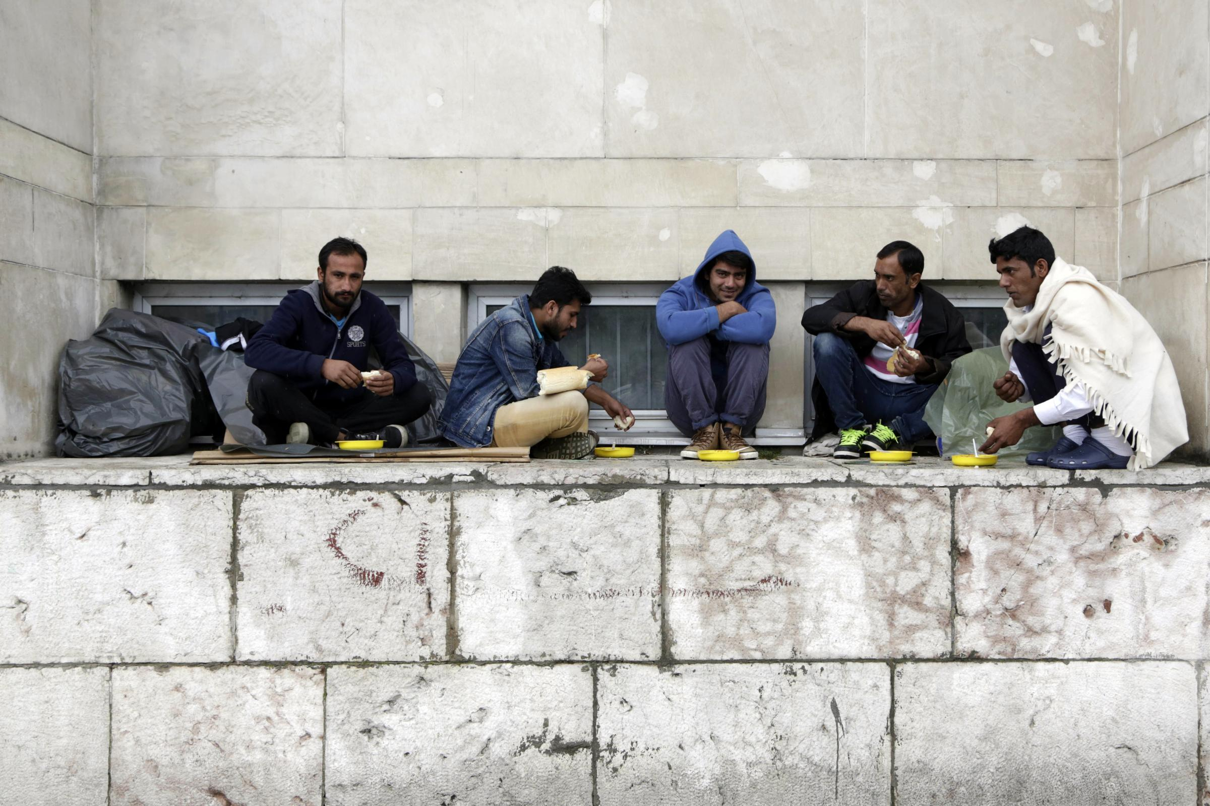Migrants from Pakistan in front of a railway station in Sarajevo, Bosnia
