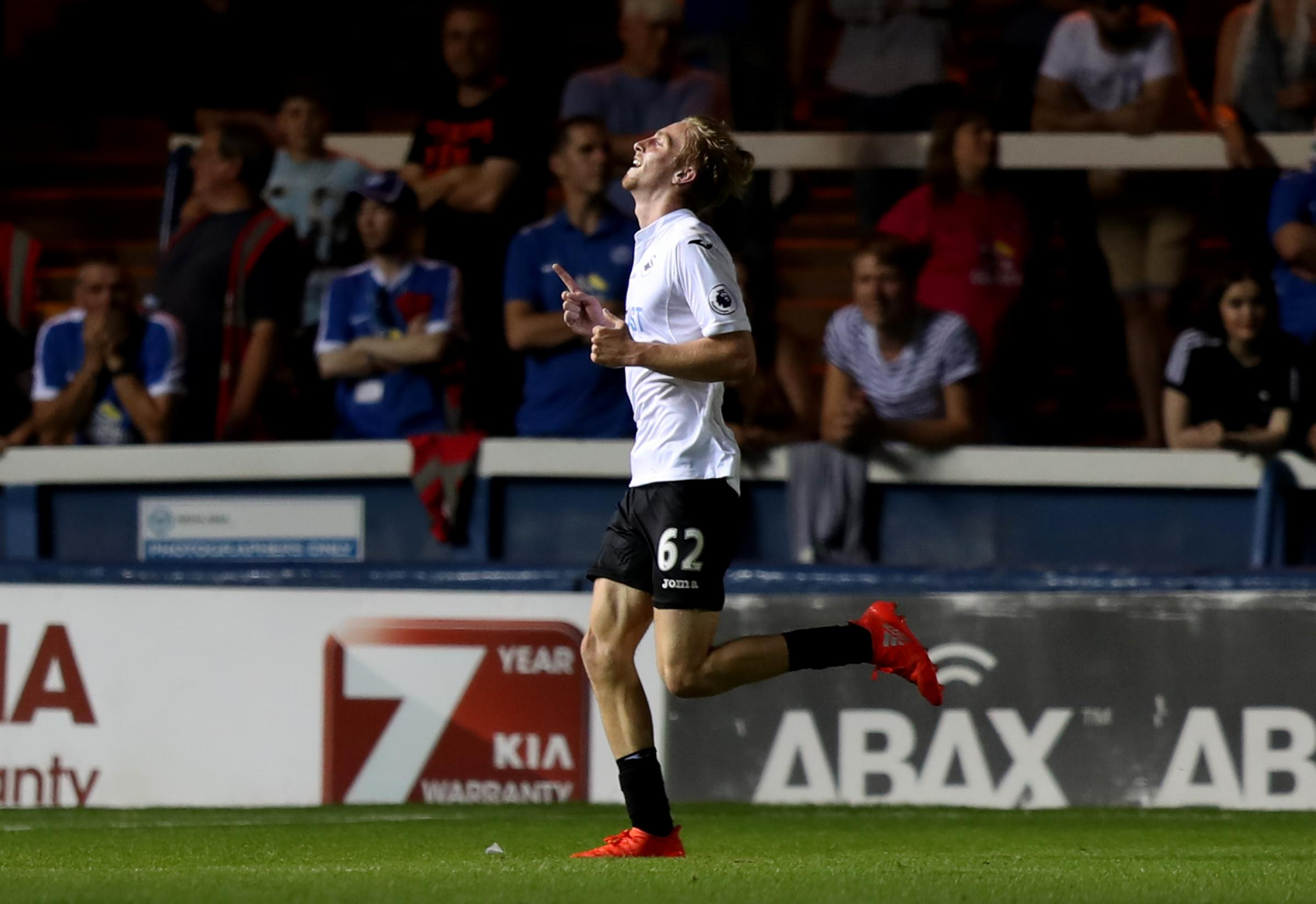 Swansea City's Ollie McBurnie celebrates scoring his side's third goal of the game during the EFL Cup, Second Round match at the ABAX Stadium, Peterborough.