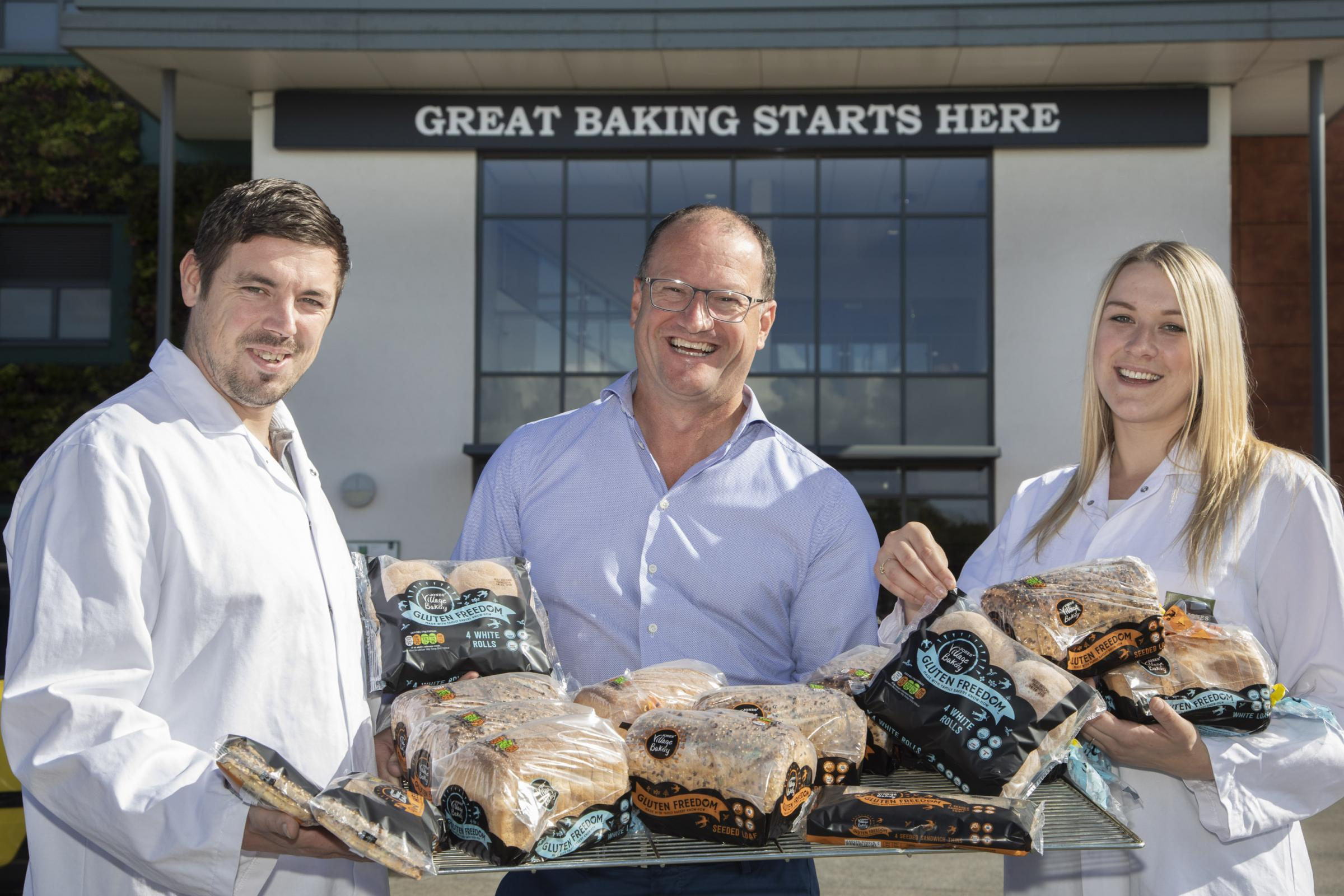 Village Bakery, Wrexham Gluten Freedom range . Pictured is MD Robin Jones (centre) with Craig Higgins and Emma Thomas from Village Bakery.