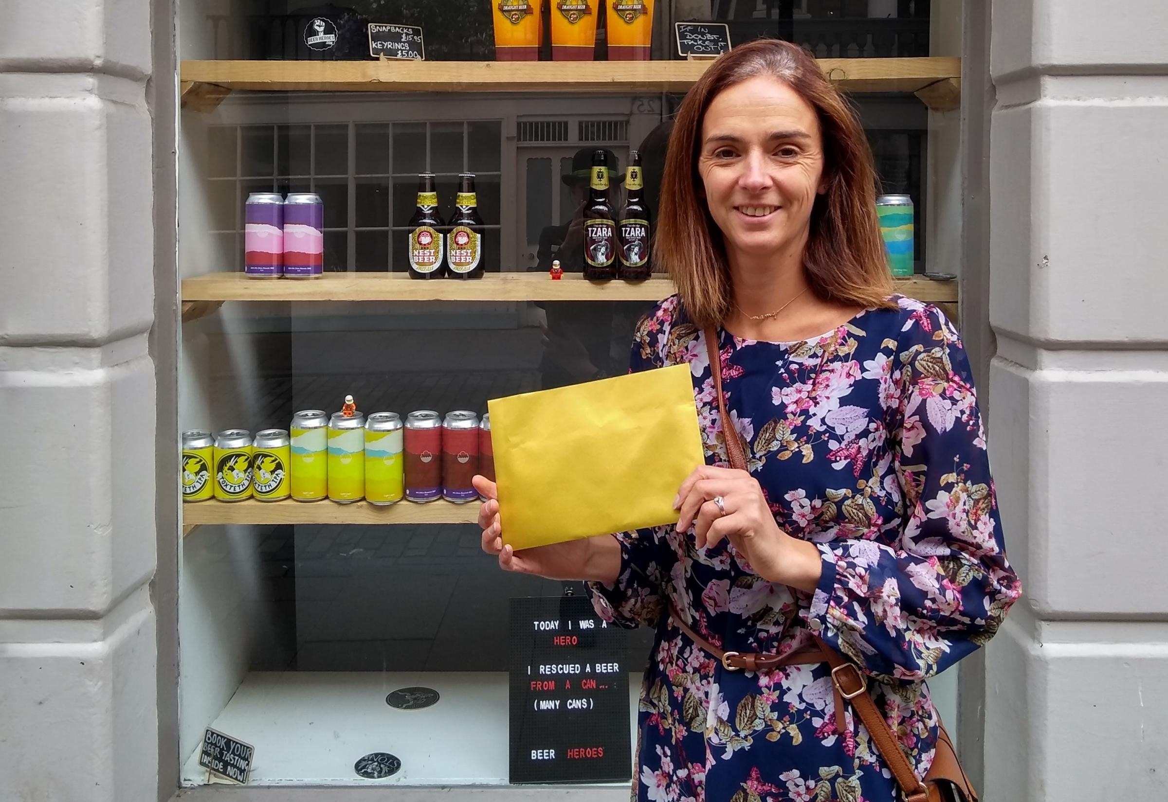 Emma Melling, the first Love Local pictured outside Beer Heroes with her prize