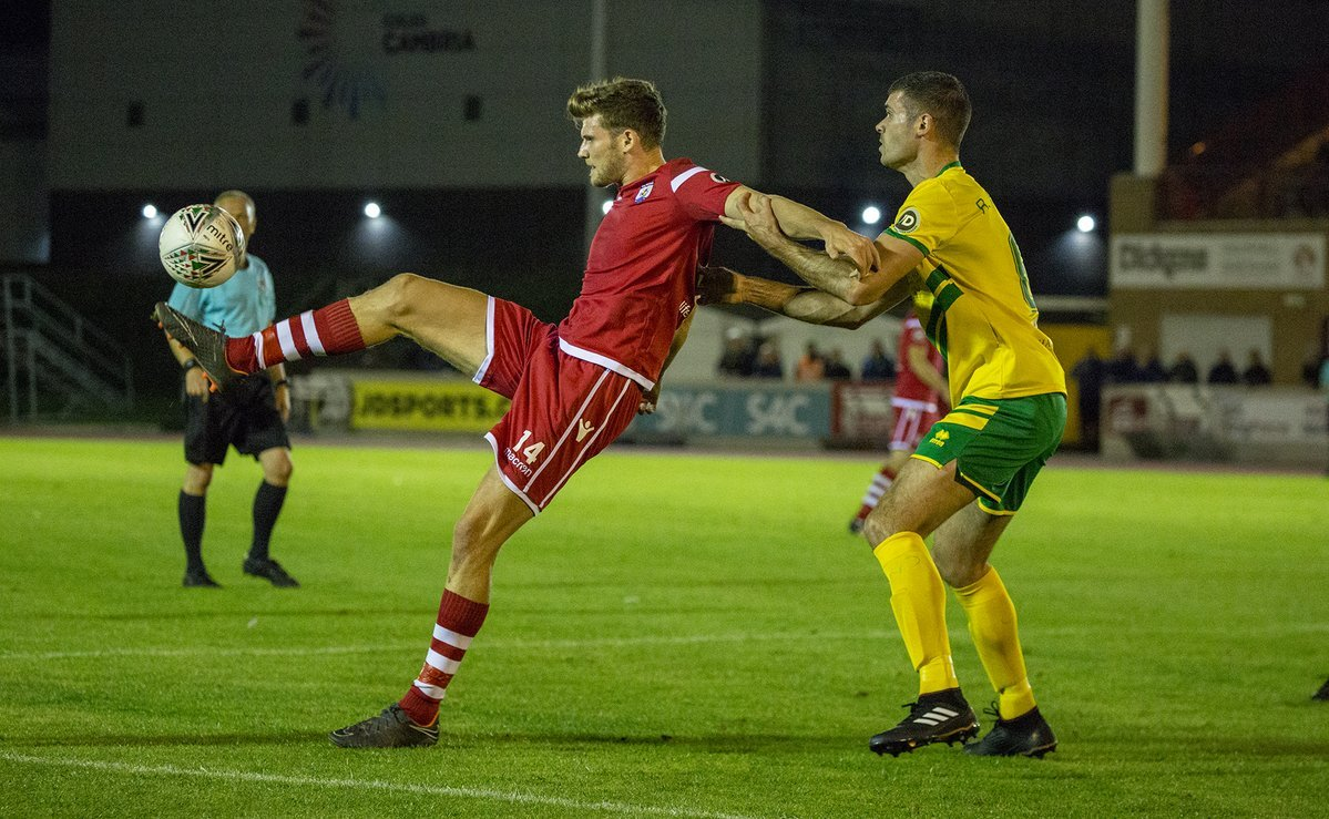 ACTION: Nomads' Jack Kenny is marshalled by the Caernarfon defence. Picture: NCM MEDIA