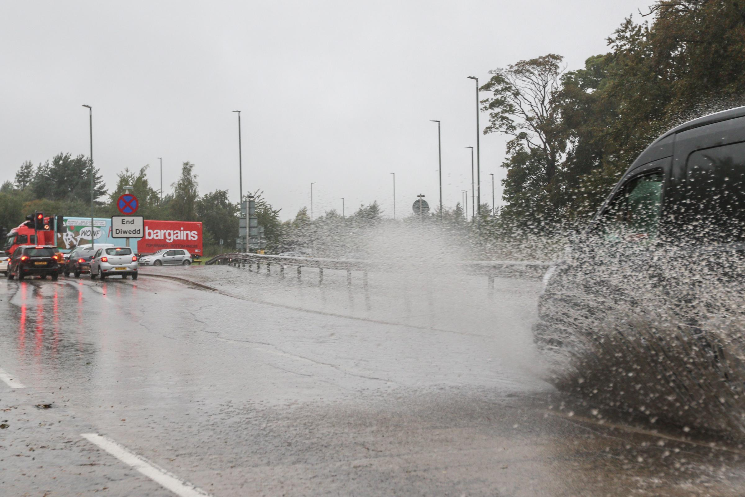 A5156 / A483 junction standing water making hazardous driving conditions
