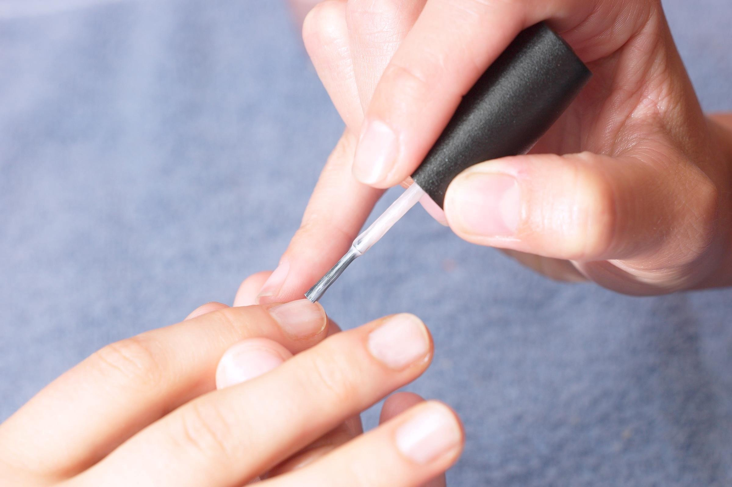 Library photo of woman having her nails varnished
