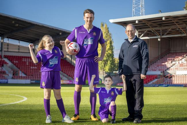 Ifor Williams Trailers WFC New kit launch; Pictured is Wrexham player Jake Lawlor with Russel Williams from Ifor Williams Trailers , Maisie Scragg,10 and Callum Hogan,6.