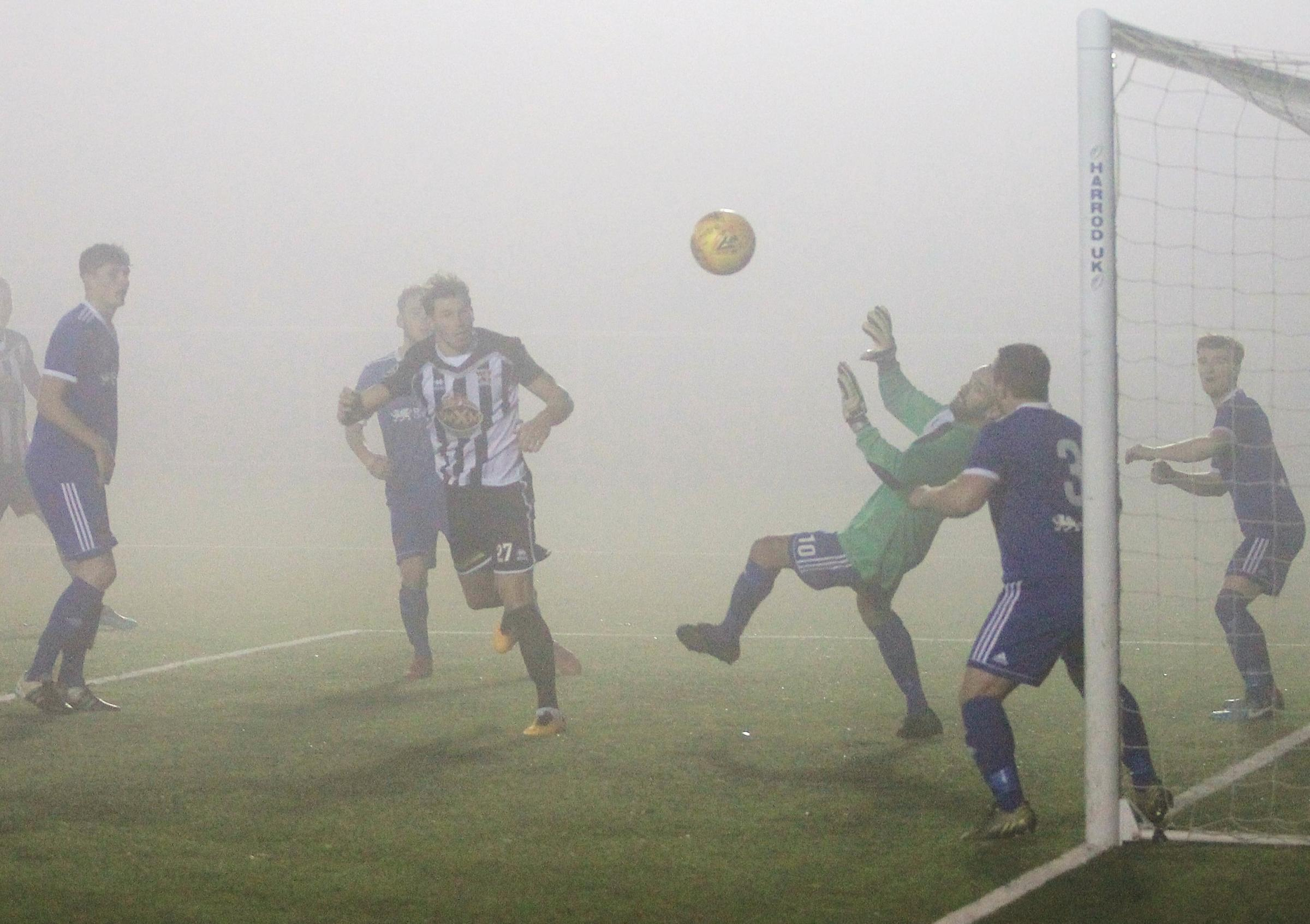 HARD TO SEE: Cefn Druids versus Ruthin. Picture: MIKE PLUNKETT