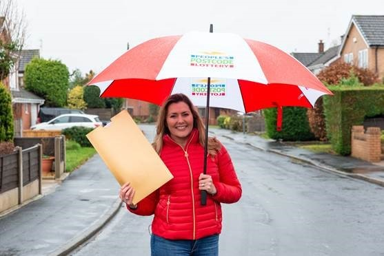 Christmas comes early for Mold neighbours who land Postcode Lottery prize