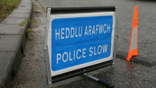 Library image of police 'slow' warning sign