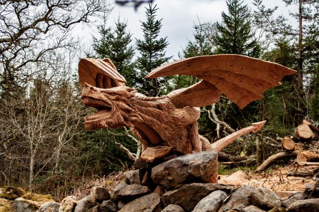 Undated handout photo of the giant dragon carved by sculptor Simon O'Rourke from a fallen tree on the A5 near Tregarth