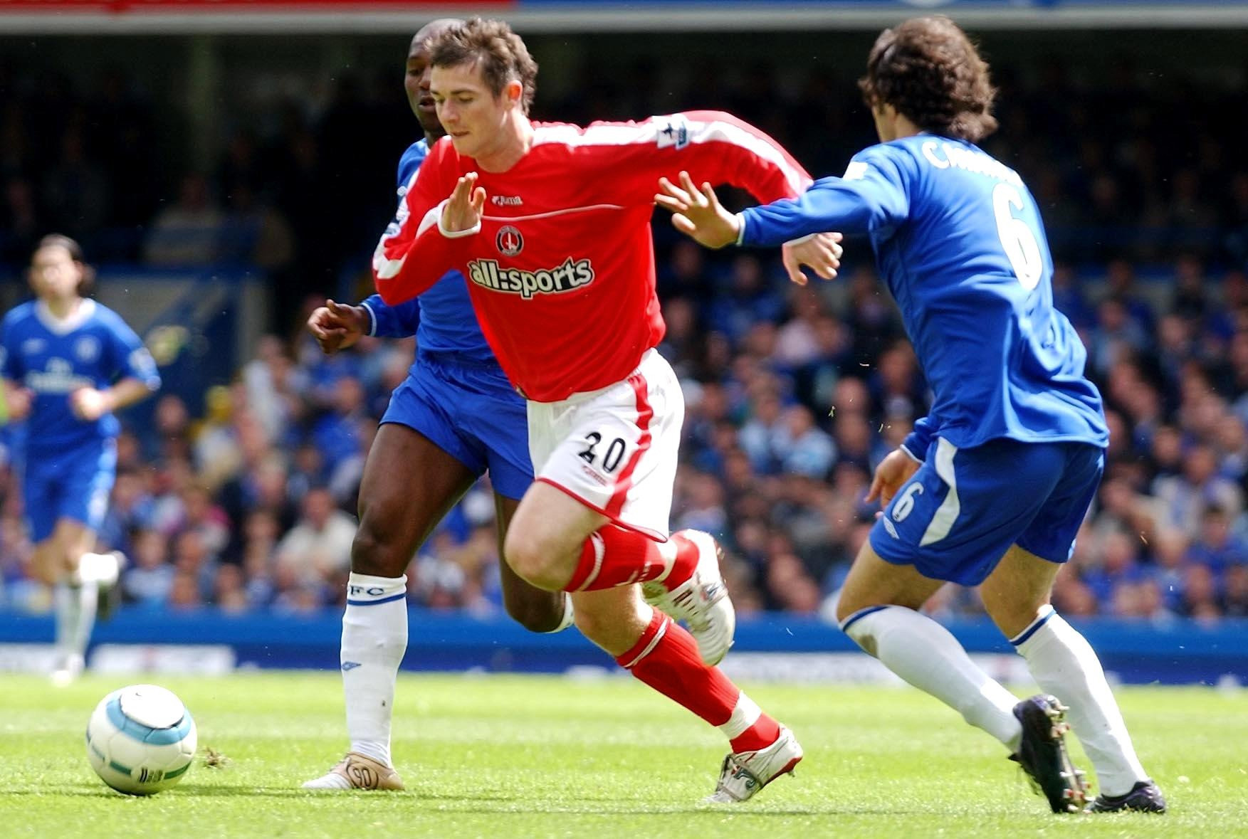 Charlton Athletic's Bryan Hughes (C) in action against Chelsea's Ricardo Carvalho (R)