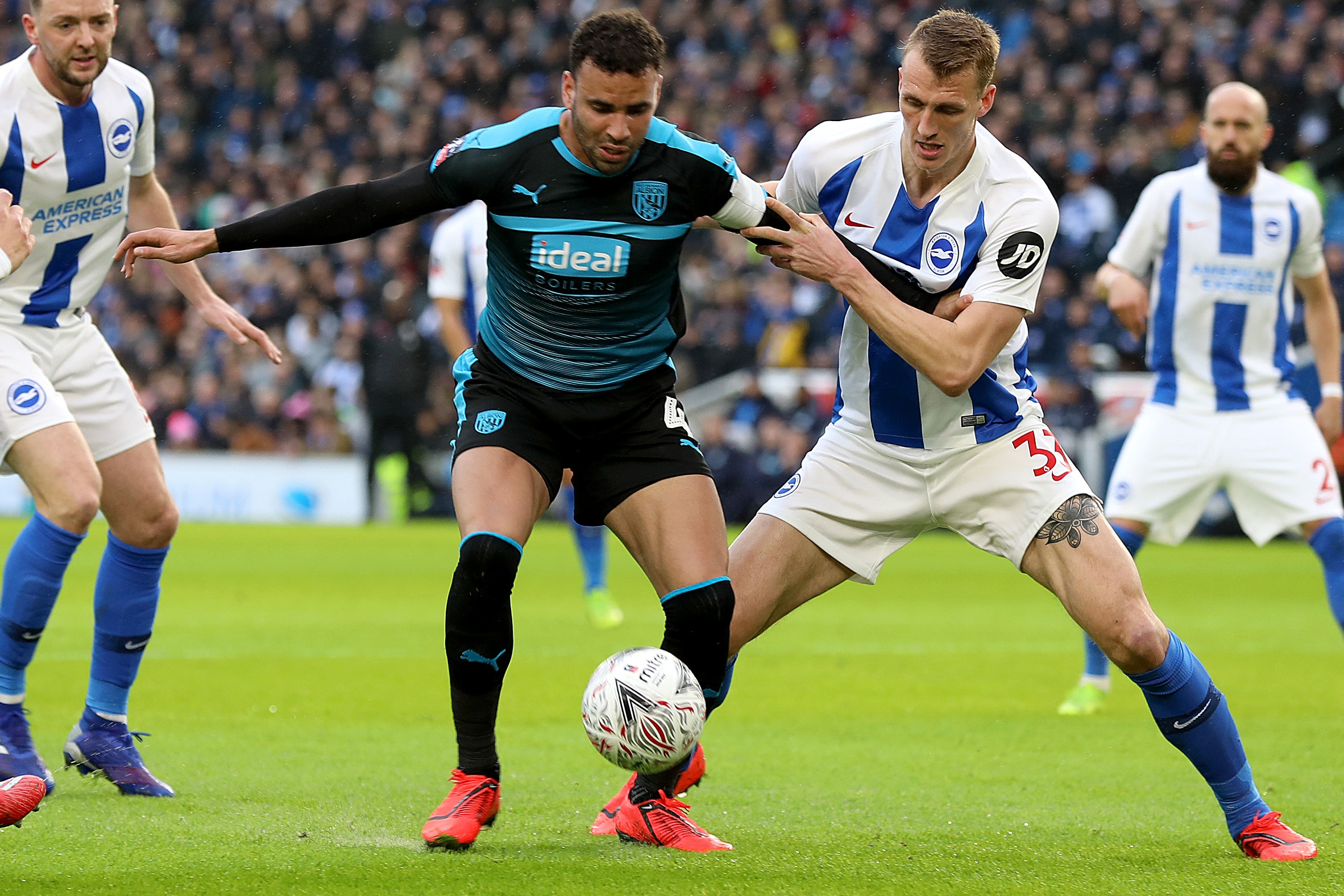 Brighton defender Dan Burn, right, enjoyed an FA Cup run with Wigan last season