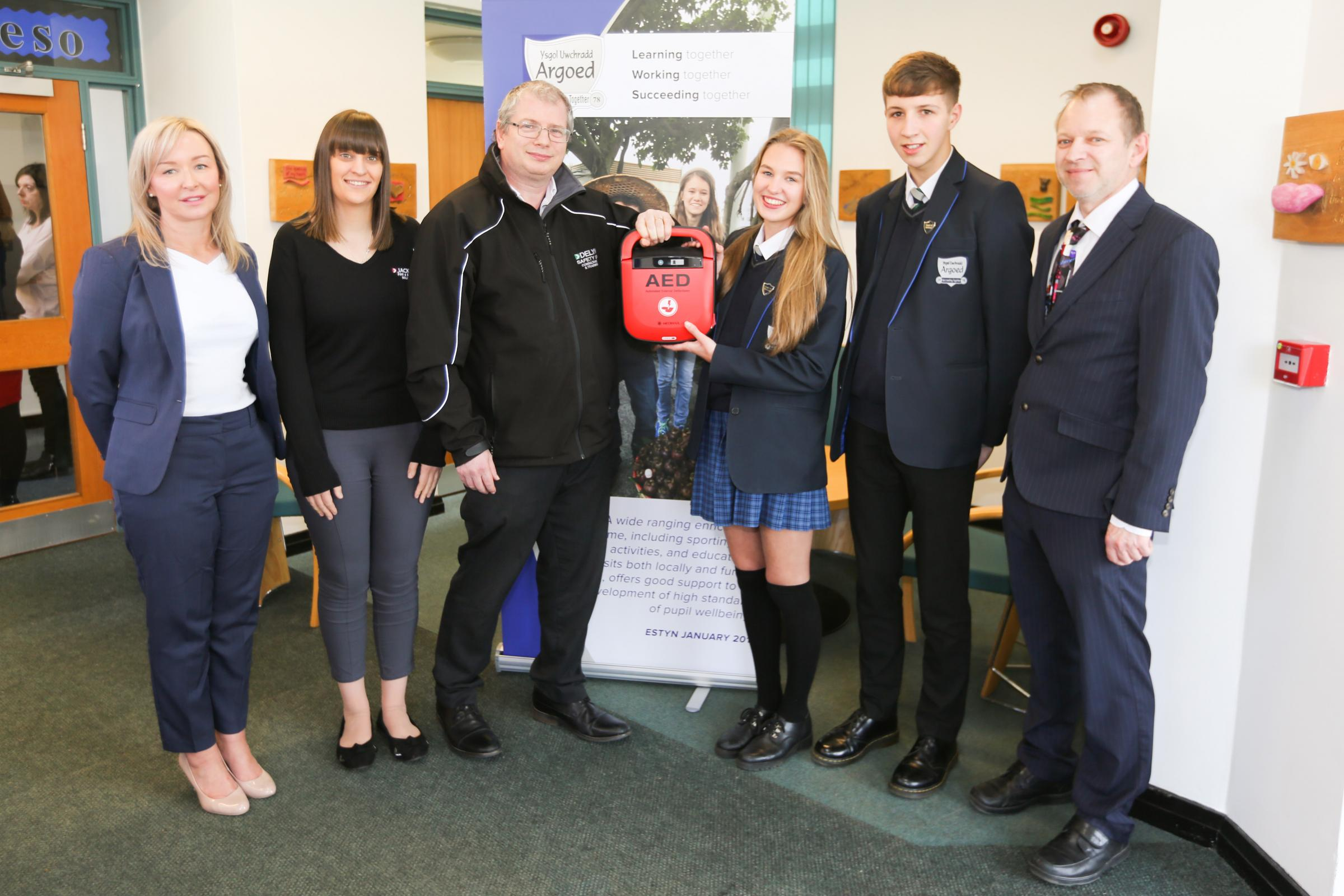 Businesses donate life-saving defibrillator to Argoed High in Mynydd Isa