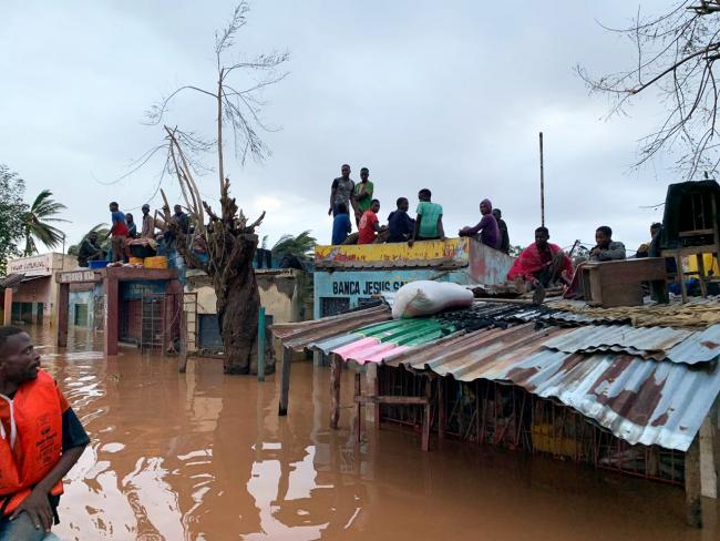 People sheltering on rooves of building in Buzi district Mozambique