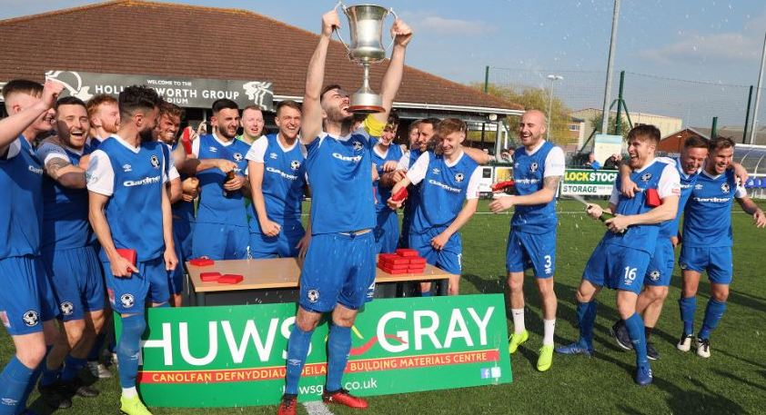 Cymru Alliance 2018/19 champions Airbus lift the league trophy.