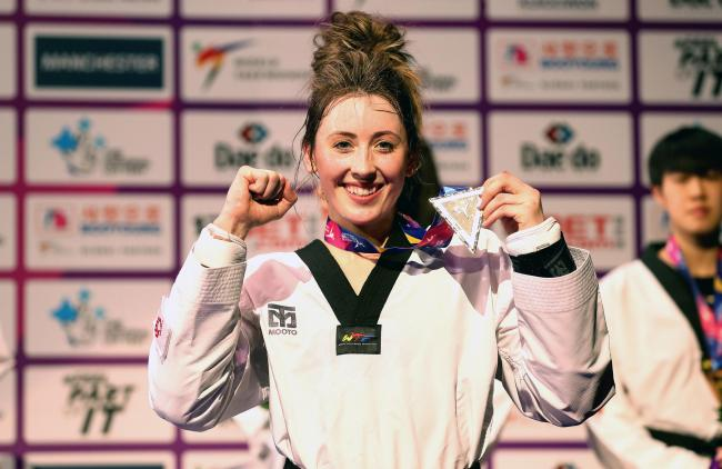 Great Britain's Jade Jones celebrates with her medal after winning the Women's -57kg final match against Korea's Ah-Reum Lee, during day four of the World Taekwondo Championships at Manchester Arena, Manchester. PRESS ASSOCIATION Photo. Pictur