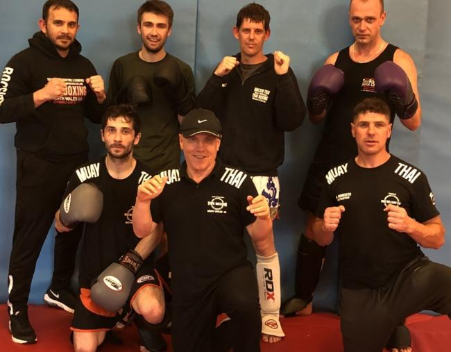 Fighters and trainers - Back: Justin Fox, Adam Williams, Wesley Jones and Adam Banas. Front: Matt Owen, Russ Williams and Andrew Roberts