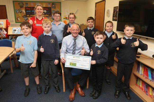 Phil Ward from SP Energy Networks gives Ysgo Yr Hafod eCadets a cheque for £400 to go towards new Chromebooks. Picture: Craig Colville (cc170519A)