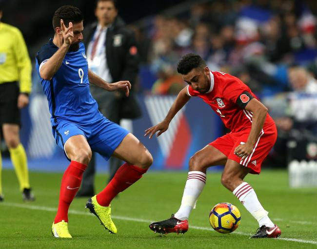France's Olivier Giroud (left) and Wales' Neil Taylor (right) battle for the ball during the International Friendly match at the Stade de France, Paris. PRESS ASSOCIATION Photo. Picture date: Friday November 10, 2017. See PA story SOCCER France. P