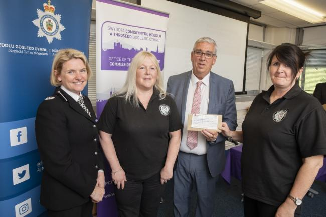 Representatives of North Wales Horse Watch receive their Your Community Your Choice award at North Wales Police Headquarters, from left, Assistant Chief Constable Sacha Hatchett, Norma Morris and Helen Lacey with North Wales Police and Crime Commissioner