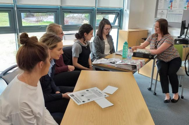 Psychology lecturer Beth Daniels with Coleg Cambria students at a mindfulness session