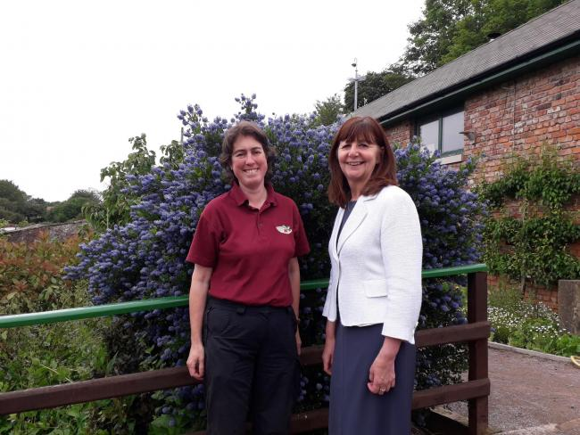 Lesley Griffiths AM alongside Libby Hughes, the Erlas Victorian Walled Garden Site Manager.